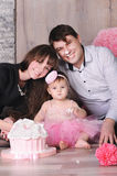 Happy family - mother, father and daughter celebrating first birthday with cake. Royalty Free Stock Photos