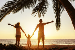 Happy family of mother father and daughter under palm royalty free stock photos