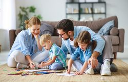 Happy family mother father and kids draw together at home royalty free stock photo