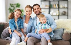 Happy family mother father and kids at home on couch royalty free stock photo