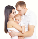 Happy family, mother and father kissing baby Royalty Free Stock Photos