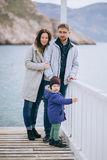 Happy family -mother, father and little son- walking in harbour Royalty Free Stock Photography