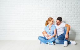 Happy family mother, father of a newborn baby on floor near blan Stock Images