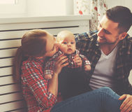 Happy family mother and father playing with a baby Royalty Free Stock Photo