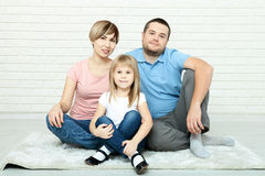 Happy family mother and father playing with baby at home Royalty Free Stock Photos