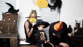 Happy family mother father and son in costumes on celebration of Halloween. Halloween celebration concept. Dad with mom stock video footage