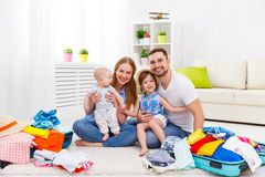 Happy family mother, father and two children packed suitcases fo. R the trip holiday travel vacation Royalty Free Stock Image