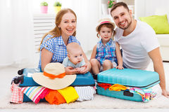 Happy family mother, father and two children packed suitcases fo. R the trip holiday travel vacation Stock Image