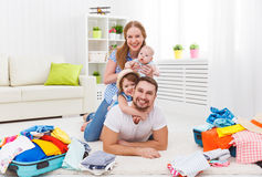 Happy family mother, father and two children packed suitcases fo. R the trip holiday travel vacation Stock Photography