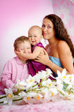 Happy family mother and her children boy and girl sitting indoor Royalty Free Stock Photography