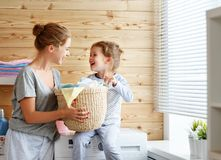 Happy family mother housewife and child   in laundry with washin Royalty Free Stock Photography