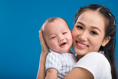 Happy family. Mother hugging her smiling little son Stock Image