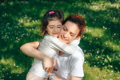 Happy family, mother hugs her daughter. Stock Image