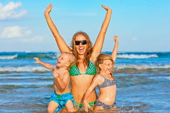Happy family - mother with kids on summer beach holidays Royalty Free Stock Photography