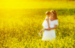 Happy family, mother and little daughter child in summer meadow Stock Image