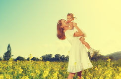 Happy family, mother and little daughter child in summer meadow Royalty Free Stock Image
