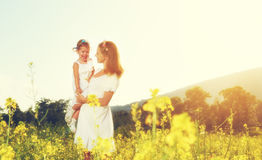 Happy family, mother and little daughter child in summer meadow Stock Images