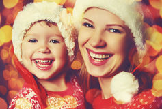 Happy family mother and little daughter playing in Christmas Royalty Free Stock Photo
