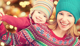 Happy family mother and little daughter playing in the winter for Christmas Royalty Free Stock Photo