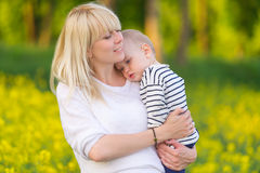 Happy family - mother and little son Stock Images