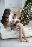 Mom with a small son near a beautiful Christmas tree in his house Royalty Free Stock Images