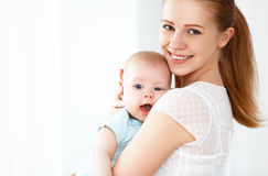 Happy family mother playing  with baby Stock Photography