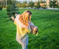 Happy family. Mother playing with her daughter on green lawn with grass Royalty Free Stock Photos