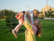 Happy family. Mother playing with her daughter on green lawn with grass Royalty Free Stock Images