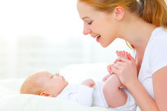 Happy family mother playing  with newborn baby Royalty Free Stock Images