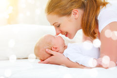 Happy family mother playing  with newborn baby Stock Image