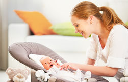Happy family. mother plays with newborn baby Royalty Free Stock Photos
