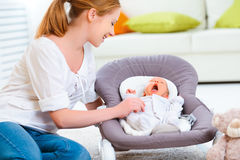 Happy family. mother plays with newborn baby Stock Image
