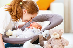 Happy family. mother plays with newborn baby Royalty Free Stock Photo