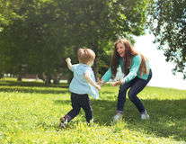 Happy family! Mother with son child playing having fun together Stock Image