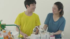 Happy family mother and son dish washing together at home with smile face stock video