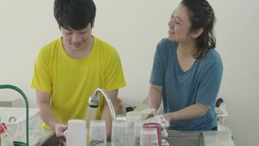 Happy family mother and son dish washing together at home with smile face stock footage