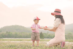 Happy family. A mother and son giving gift box on outdoors at ev. Happy family. A mother and son giving gift box Royalty Free Stock Photo