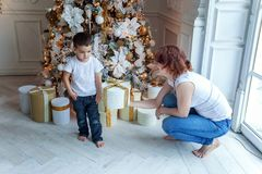 Mother and son near a Christmas tree Stock Image