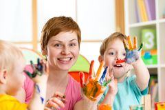 Happy family - mother and sons having fun with. Happy family - mother and sons kids having fun with paints stock image