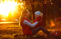Happy family mother and toddler outdoors in park Stock Image