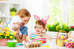 Happy family mother and two children preparing for Easter, paint Royalty Free Stock Photos