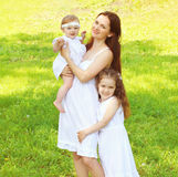 Happy family, mother and two daughters childrens together Stock Image