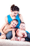 Happy family: mother and two little sons Royalty Free Stock Photo