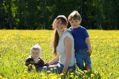 Happy family of mother and two sons Stock Photo