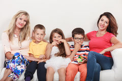 Happy family. Mothers and kids on sofa at home. Stock Image
