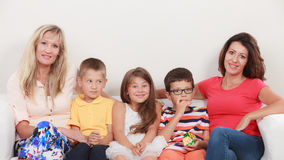 Happy family. Mothers and kids on sofa at home. Stock Photo