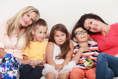 Happy family. Mothers and kids on sofa at home. Royalty Free Stock Photos