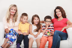 Happy family. Mothers and kids on sofa at home. Stock Photography