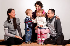 Happy family. Mothers women and kids little girl and boys sittin Stock Photo