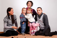 Happy family. Mothers women and kids little girl and boys sittin Stock Photography